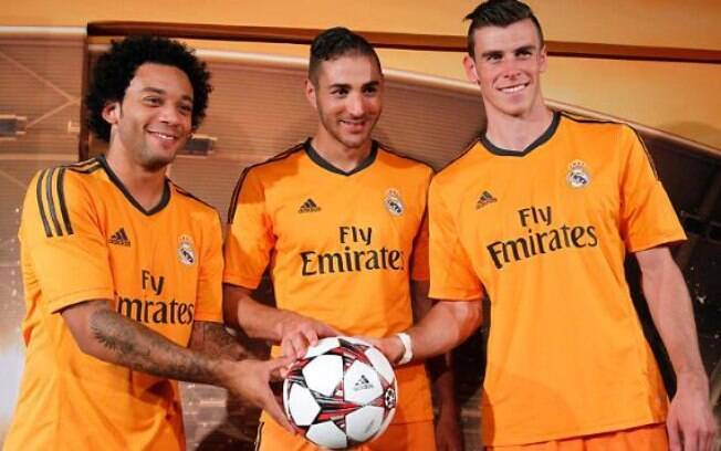 Marcelo, Benzema e Bale exibem o uniforme laranja do Real Madrid